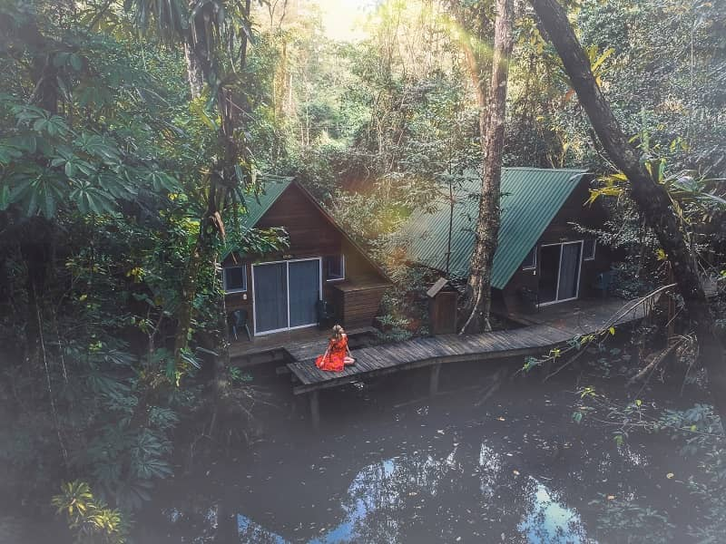 A solo female traveler chilling in a bamboo house of Guatemala