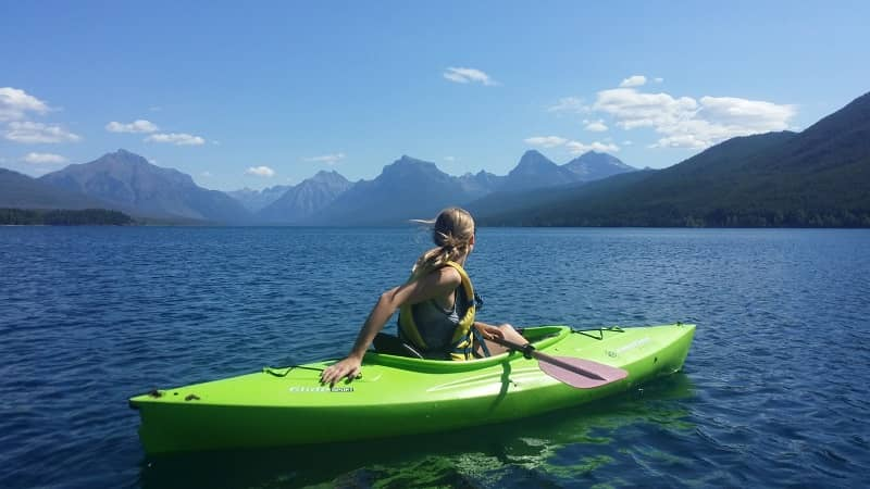 A solo female traveler riding boat in the sea at Montana