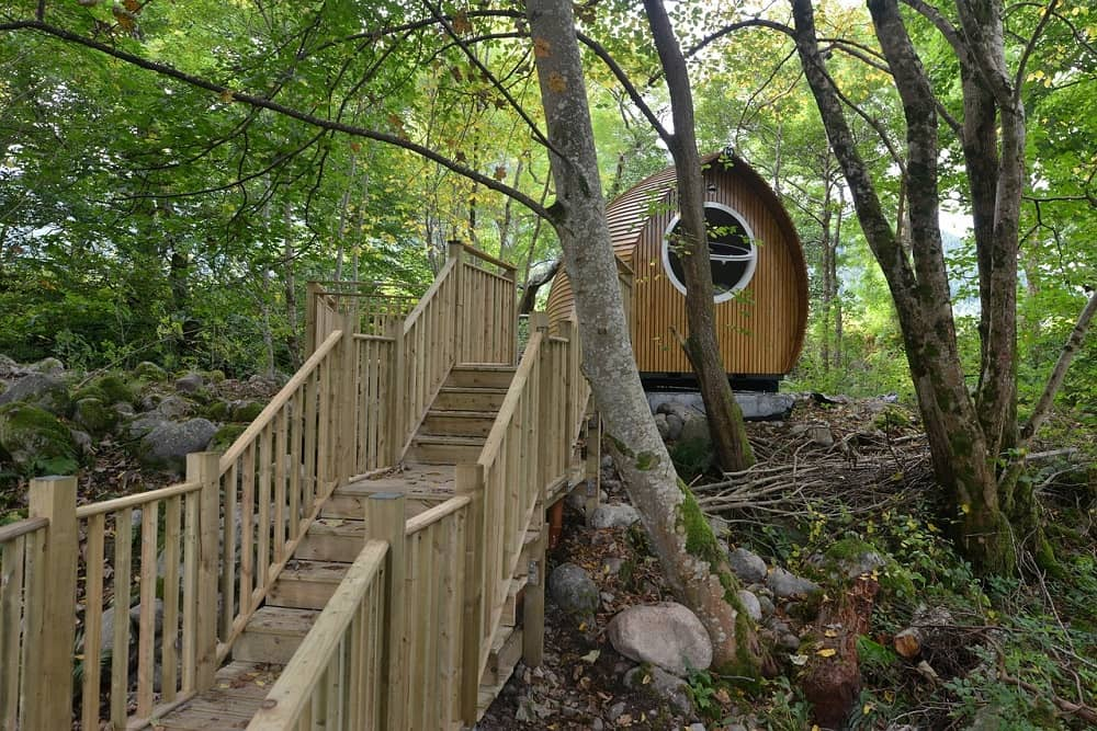 Small wooden house and stairs in the forest